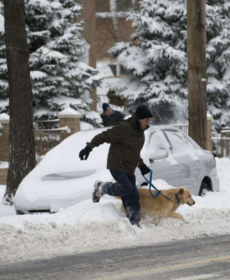 The winter storm that swept up the East Coast left about a foot of snow in the New York City area. The eastern seaboard from North Carolina to New England was digging out Sunday from the worst blizzard in years, which closed train and bus service, paralyzed air traffic and left hundreds of thousands of residents without power in some areas. Photo: DON EMMERT, AFP/Getty Images