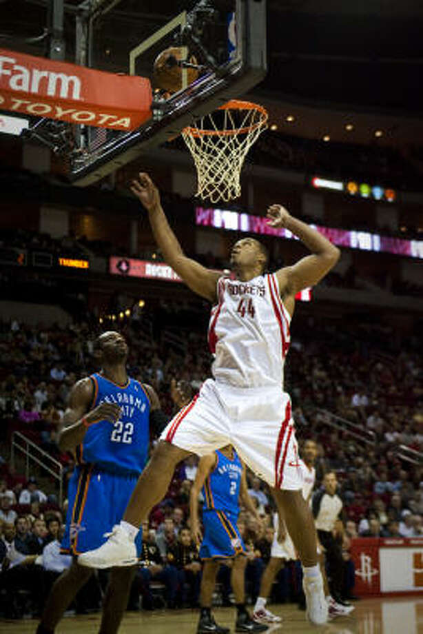 Rockets center Chuck Hayes goes up for a shot in Saturday's game against the Oklahoma Thunder at Toyota Center. Hayes had a double-double of 13 points and 15 rebounds to lead the Rockets to a 95-90 win over the Thunder. Photo: Michael Paulsen, Chronicle