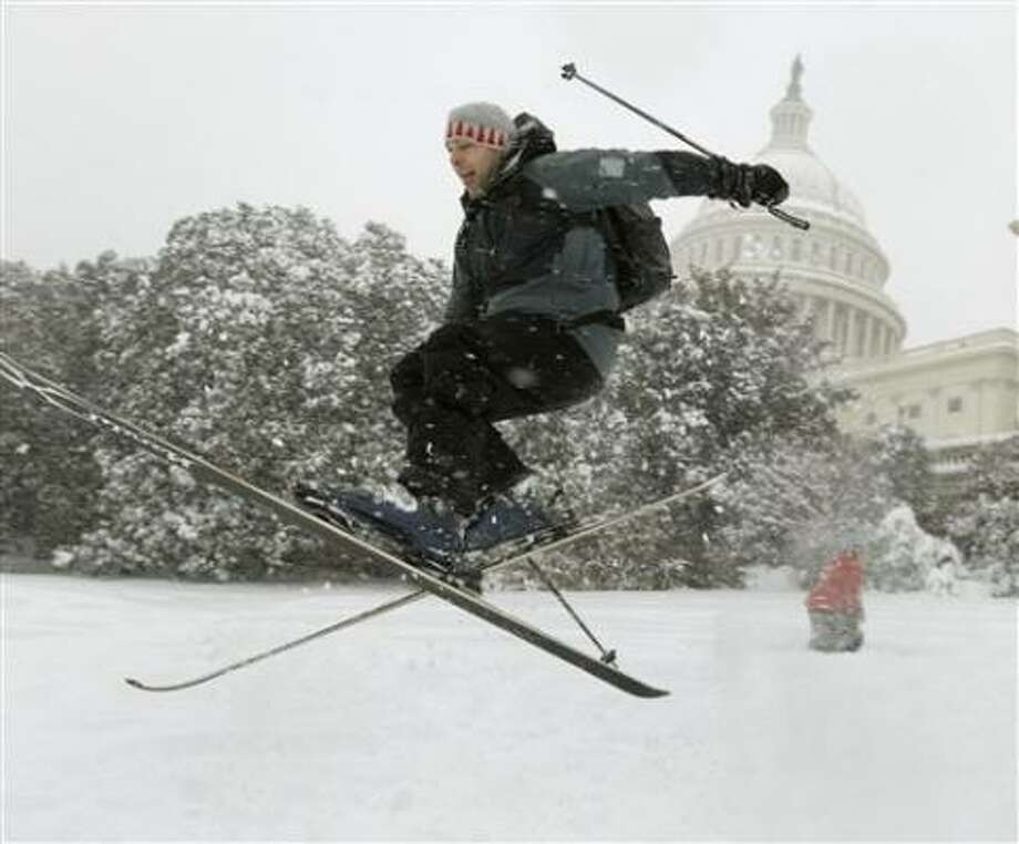Andrew Kermick, who works on Capitol Hill, goes airborne as he skis in the snow on the West Front of the U.S. Capitol. Photo: Alex Brandon, AP