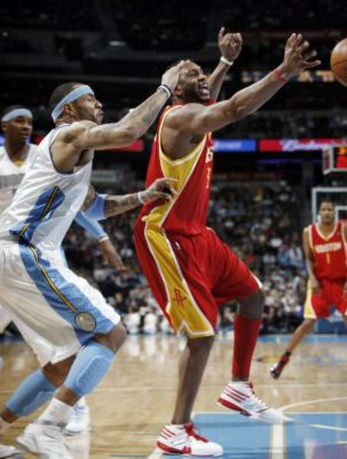 Dec. 16: Nuggets 111, Rockets 101Rockets forward Tracy McGrady loses control of the ball as Nuggets forward Kenyon Martin covers in the first half. Photo: David Zalubowski, AP