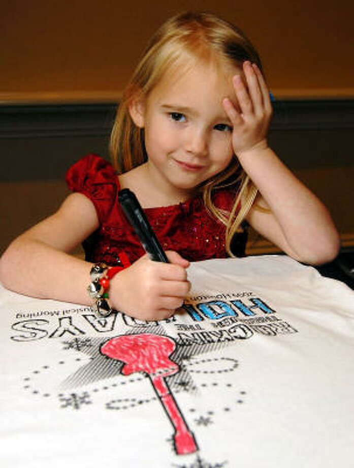 Hannah Klein, 4, of Tomball colors a t-shirt at the Houston Symphony Society and the Houston Symphony League's annual Magical Musical Morning event at the Houstonian. Photo: Dave Rossman, For The Chronicle