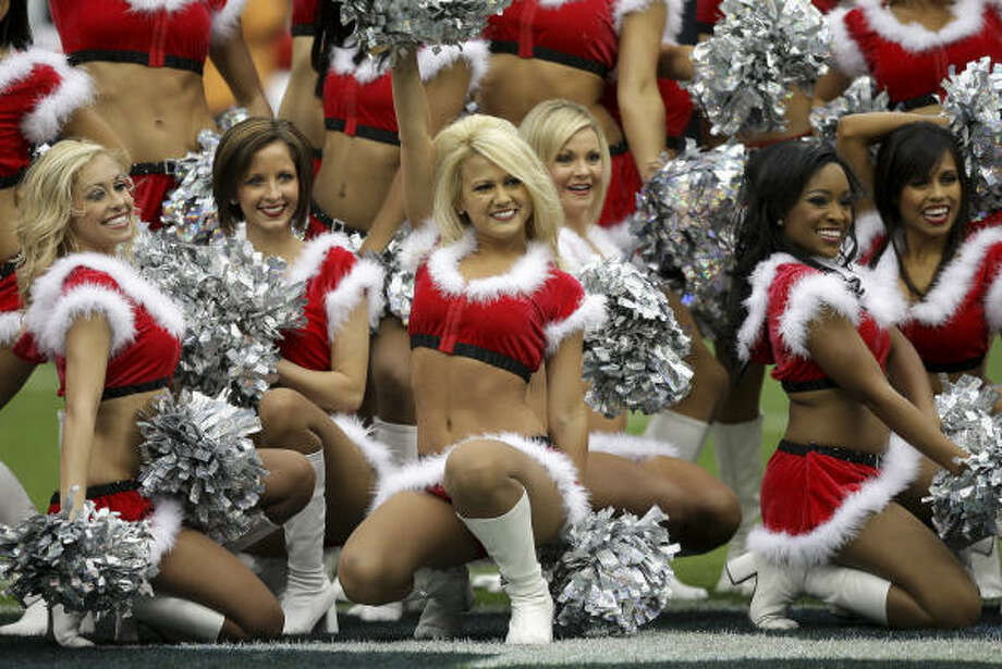 Texans Cheerleaders perform in their Christmas attire against the Seattle Seahawks at Reliant Stadium. Photo: Bob Levey, Getty Images