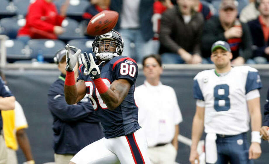 Texans wide receiver Andre Johnson makes a 64-yard touchdown catch on the opening play of the game. Photo: Nick De La Torre, Chronicle