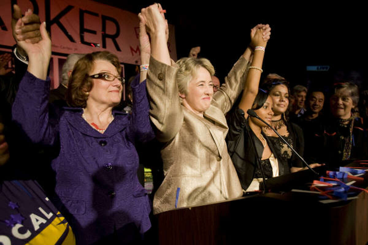 Annise Parker, center, and her partner, Kathy Hubbard, left, celebrate the election night victory on Saturday at the George R. Brown Convention Center.