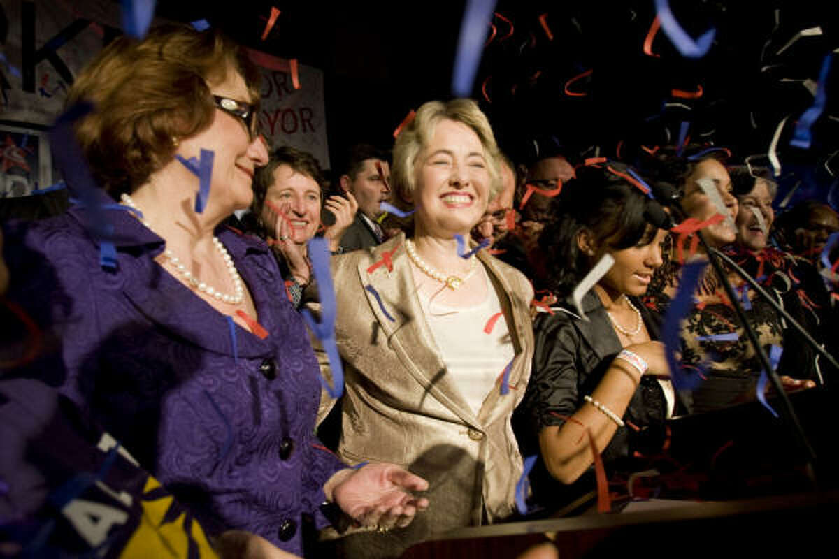 Confetti rains on a victorious Annise Parker, center, with partner Kathy Hubbard, left, at the George R. Brown Convention Center on Saturday night.