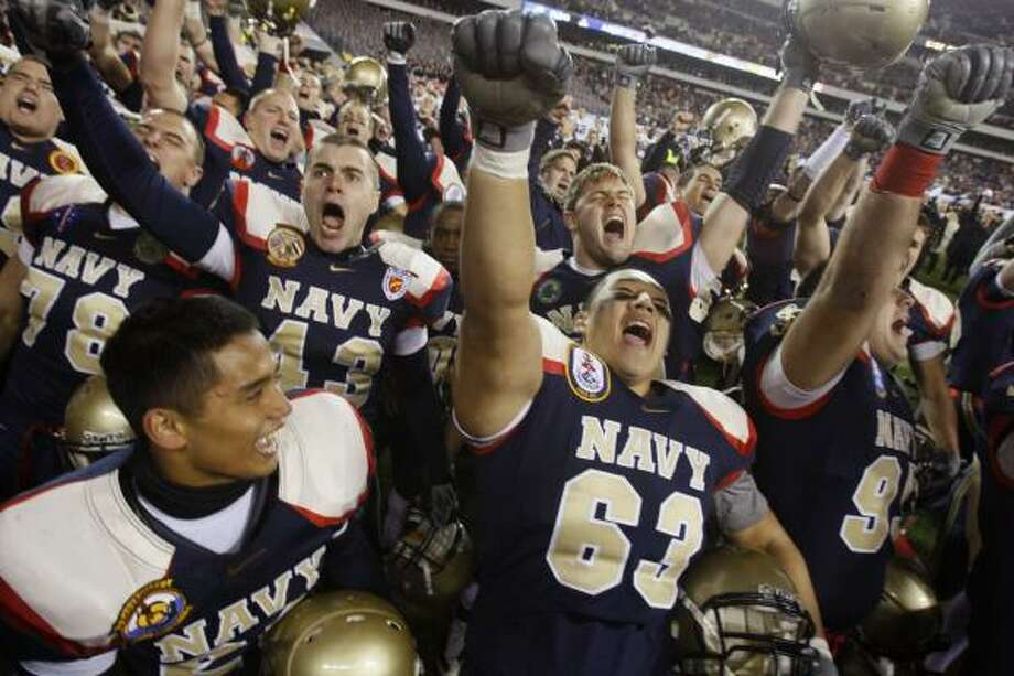 Navy celebrates beating its fiercest rival like it did for the previous seven years. The Midshipmen will play next in Houston at the Dec. 31 Texas Bowl. Photo: Matt Slocum, AP