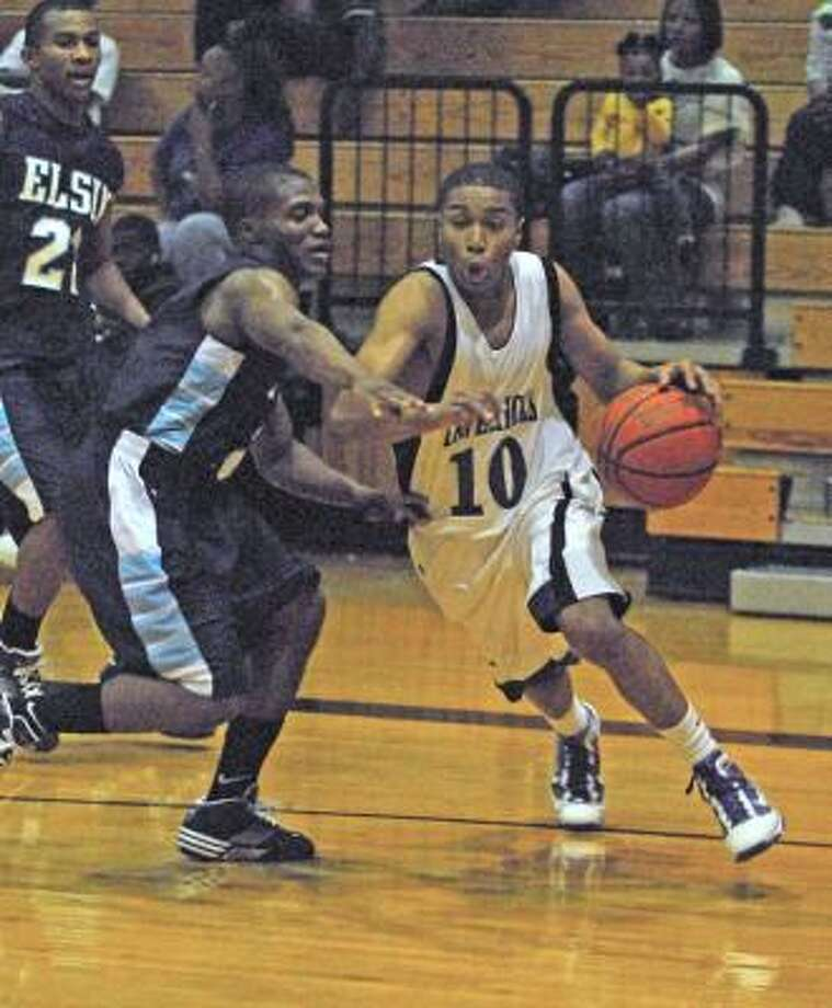 ALIEF ELSIK 60, MORTON RANCH 56:Michael Harmon of Morton Ranch dribbles the ball around Fred Massey of Alief Elsik and drives to the basket during their game on Nov. 28. Photo: Tony Bullard, For The Chronicle