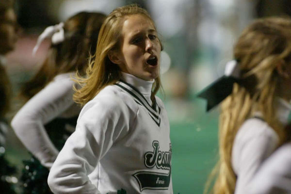 The Strake Jesuit cheerleaders cheer their team on from the sidelines.