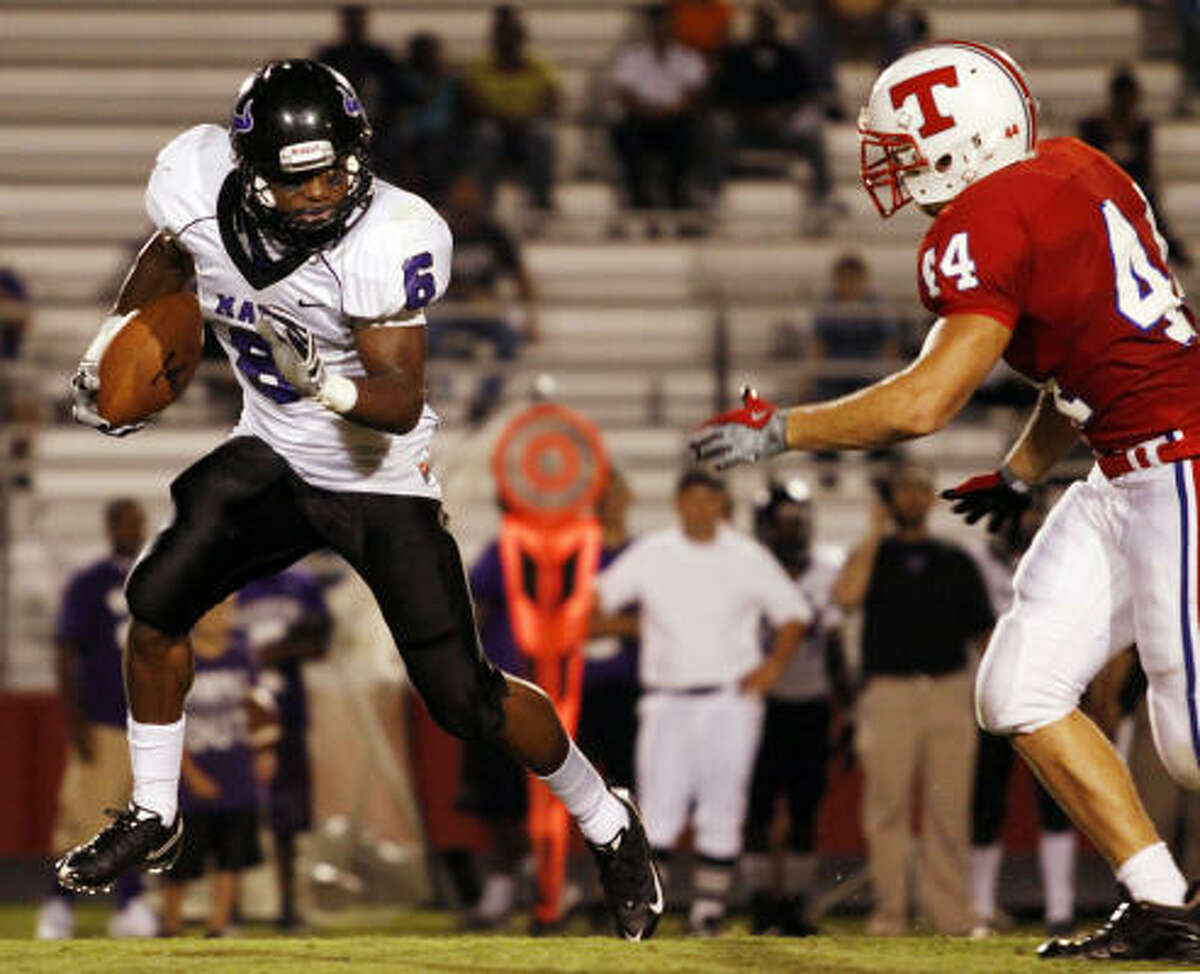 Morton Ranch running back Wes Hudson attempts to avoid Tomball defensive end Dalton Tuley.