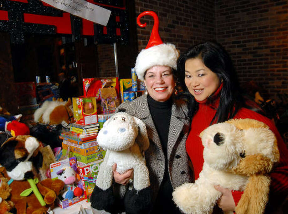 Chairs Andy Delery and Gigi Huang at the Carmen and David Bridges Joyful Toyful Fiesta 19th Annual Holiday Toy Drive Party at Gigi's Asian Bistro & Dumpling Bar in the Galleria. Photo: Dave Rossman, For The Chronicle
