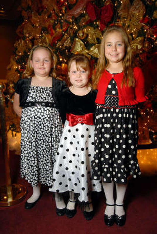 From left: Emillee Denton, 7, Raylee Clark, 6, and Kaydee Denton, 9, at the opening night of The Nutcracker at the Wortham Theater. Photo: Dave Rossman, For The Chronicle