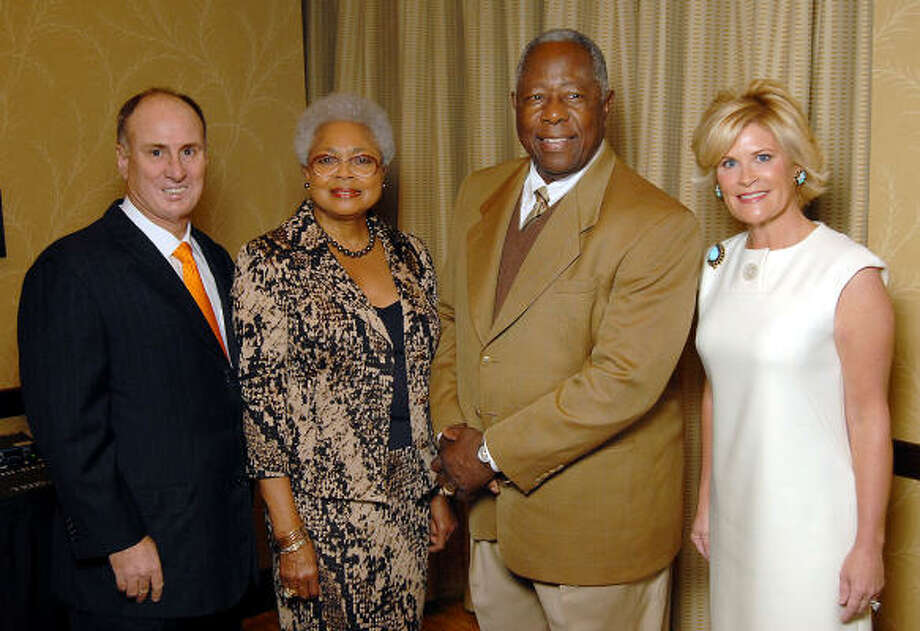 "From left: Eddy Blanton, Billye and Hank Aaron and Kelli Blanton at the M.D. Anderson fundraising luncheon ""A Conversation with a Living Legend"" with Hank Aaron at the Hilton Americas Hotel on Dec. 3. Photo: Dave Rossman, For The Chronicle"