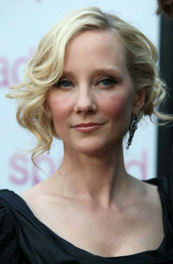 """Looking for more famous people problems? Check out these celeb complaints from the previous week: Anne Heche had a particularly difficult time shooting scenes for her movie, """"That's What She Said,"""" in an actual bar and a real pizza parlor, where they were making real pizza, instead of on a film set with amenities like makeup and hair chairs. """"I was so tired I couldn't even stand and my chair didn't even have a back to it because it was a stool. I was sitting there smelling garlic at 4 a.m."""" We're so sad after reading this, we can hardly get any work done. Off to hair and makeup for a little freshening up.  Photo: Frazer Harrison, Getty Images For Anchor Bay"""