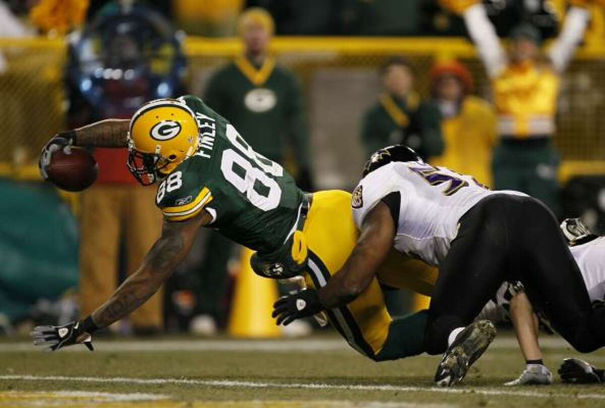 Packers 27, Ravens 14 Jermichael Finley's touchdown was a rare break from interceptions and penalties in this mess of a Monday Night Football matchup.