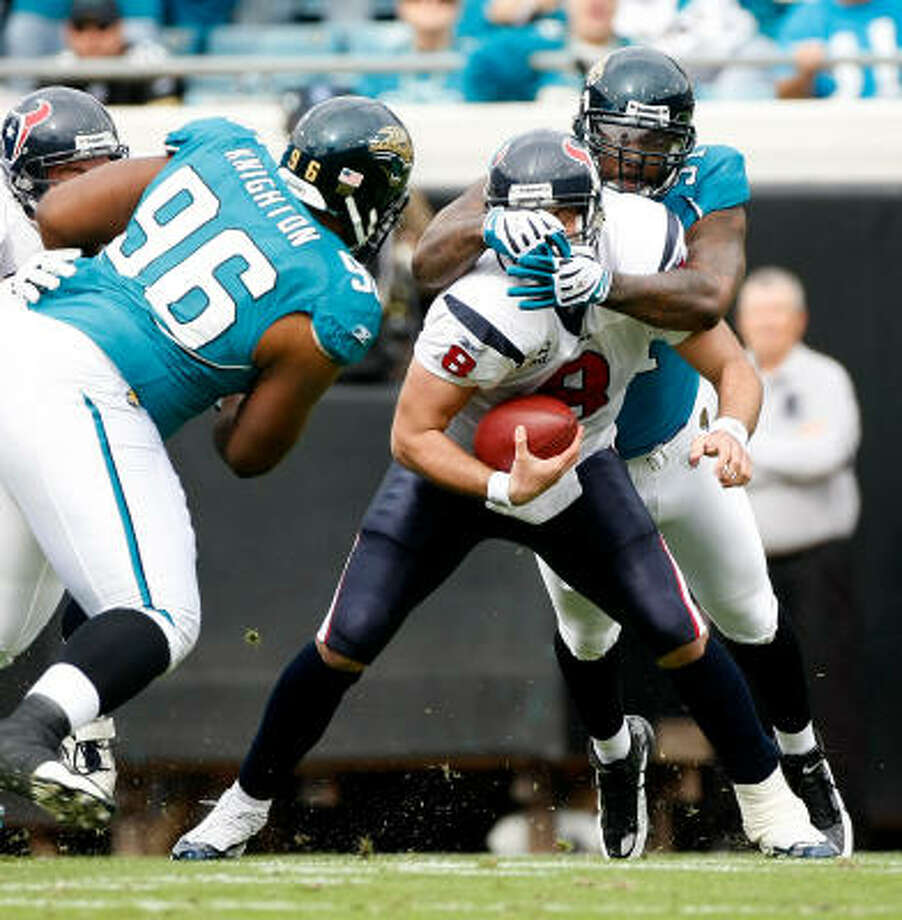 Texans quarterback Matt Schaub is sacked by Jaguars defensive end Derrick Harvey (91) in the first quarter. Schaub missed most of the first half with a shoulder injury. Photo: Nick De La Torre, Chronicle