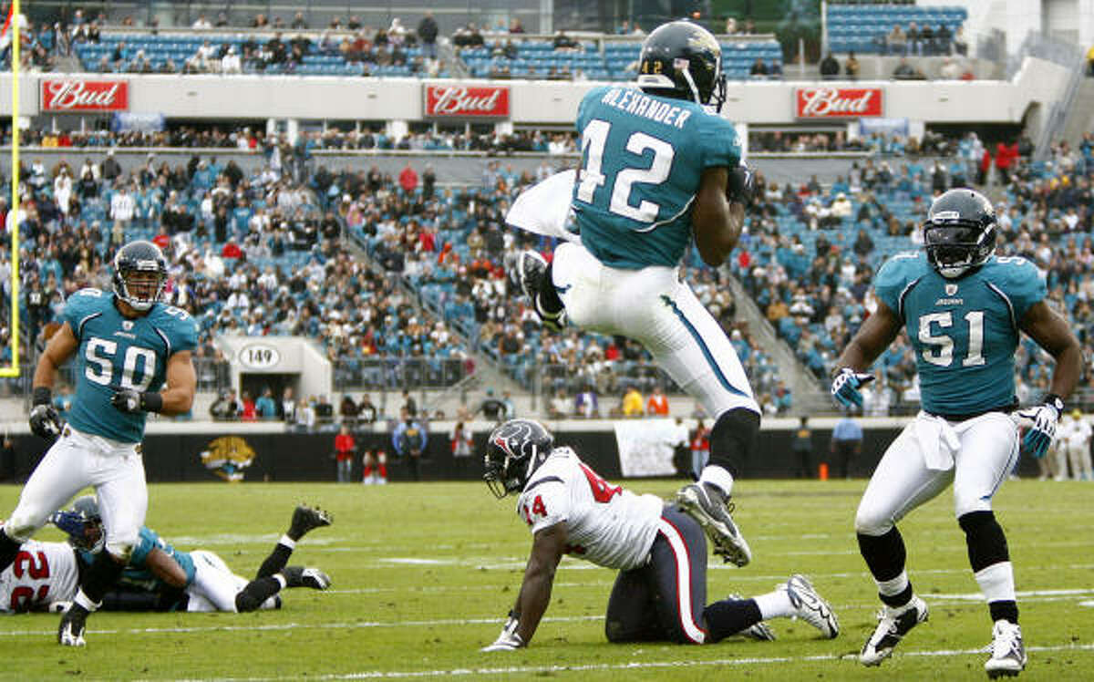 Jaguars safety Gerald Alexander intercepts a ball thrown by Texans running back Chris Brown in the fourth quarter. The Jaguars won 23-18 to hand the Texans their fourth straight loss.