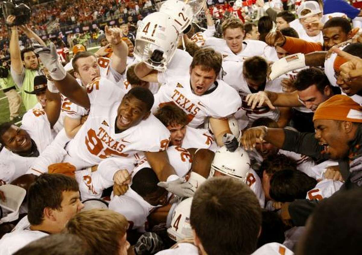 The Texas Longhorns celebrate their 13-12 victory over the Nebraska Cornhuskers at Cowboys Stadium.