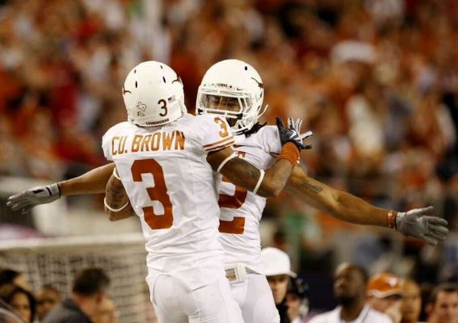 Texas teammates Curtis Brown (3) and Earl Thomas (12) celebrate breaking up a pass against the Nebraska Cornhuskers in the third quarter. Photo: Ronald Martinez, Getty Images