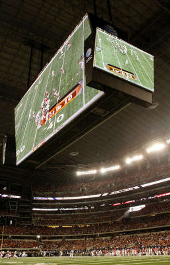 The large television screens at Cowboys Stadium are seen over the field during the Big 12 championship. Photo: Ronald Martinez, Getty Images