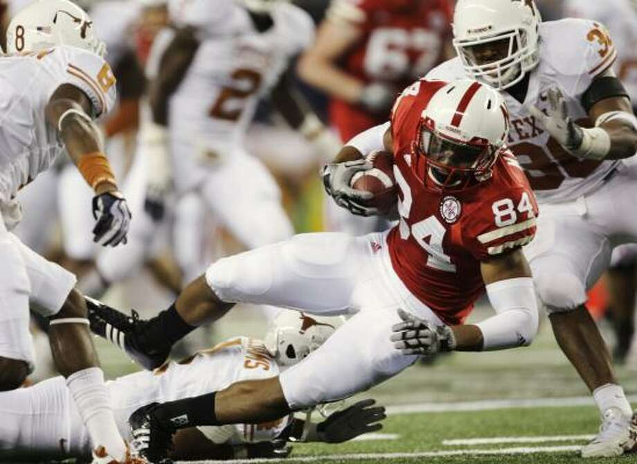Nebraska's Brandon Kinnie fights for extra yardage against the Longhorns in the third quarter. Photo: Jamie Squire, Getty Images