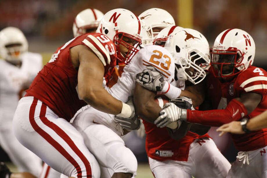 Nebraska Ndamukong Suh (93) and Larry Asante (4) tackle Texas's Tre' Newton. Photo: Richard W. Rodriguez, MCT