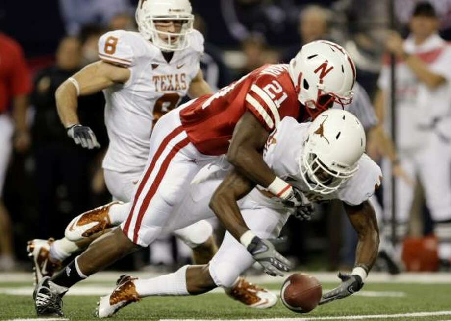 Nebraska's Prince Amukamara, top, tackles James Kirkendoll in the first quarter. Photo: Jamie Squire, Getty Images