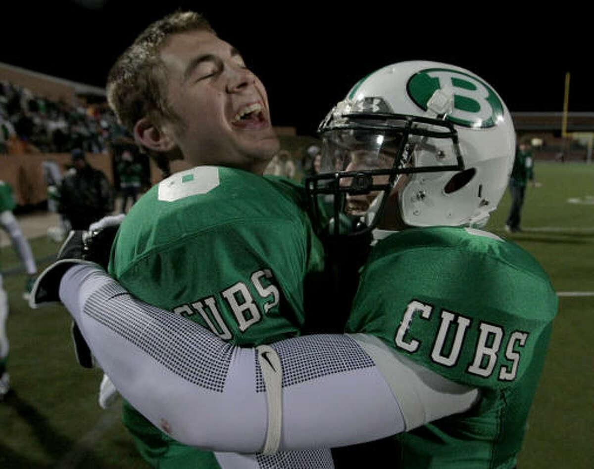 Brenham 30, Dayton 24 Brenham quarterback Ty Schlottman (8) and running back Travis Pearce (1) celebrate their victory against the Dayton Broncos.