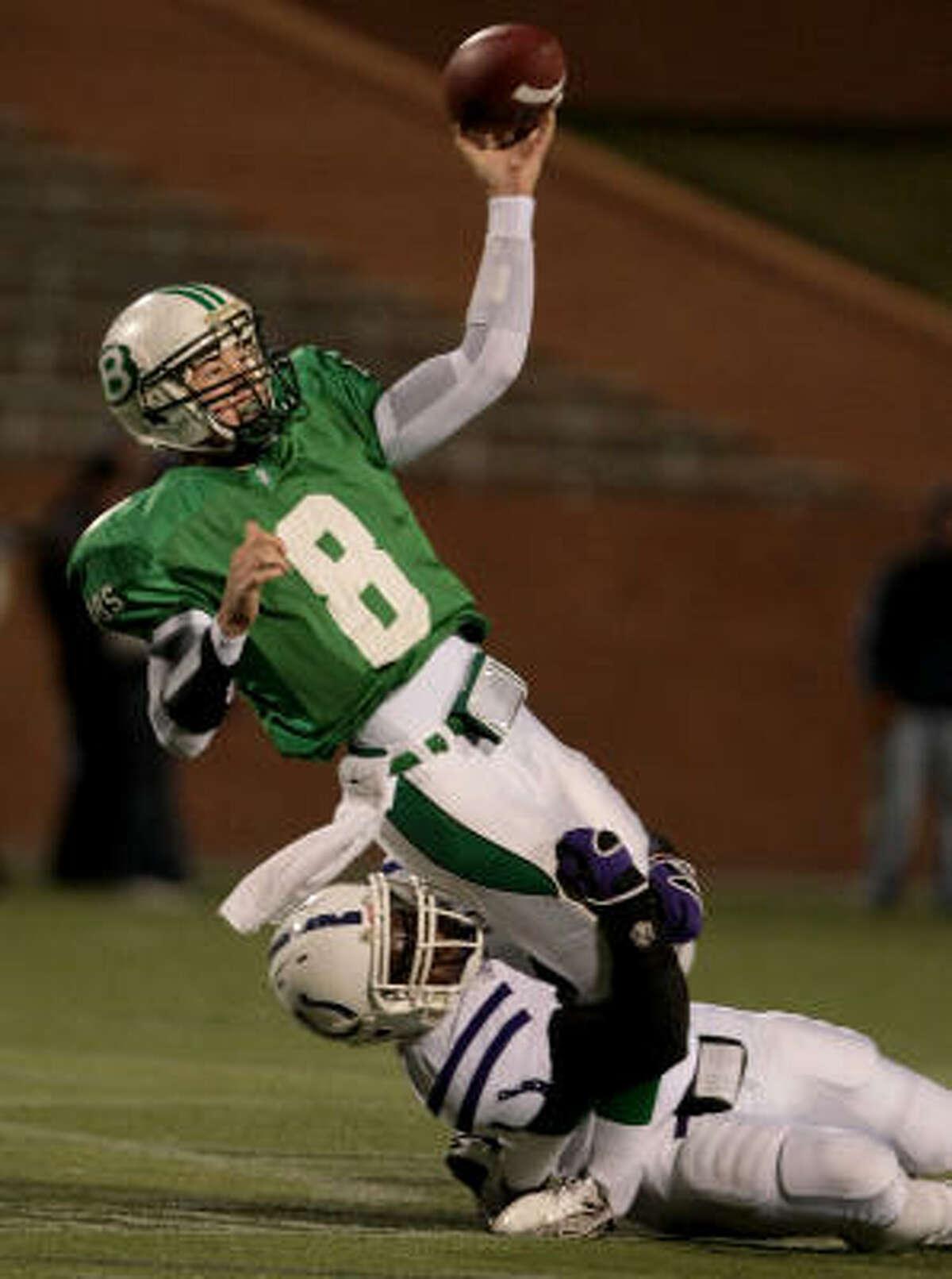 Brenham quarterback Ty Schlottmann gets rid of the ball before being taken down by Dayton tackle Darrian Wright.