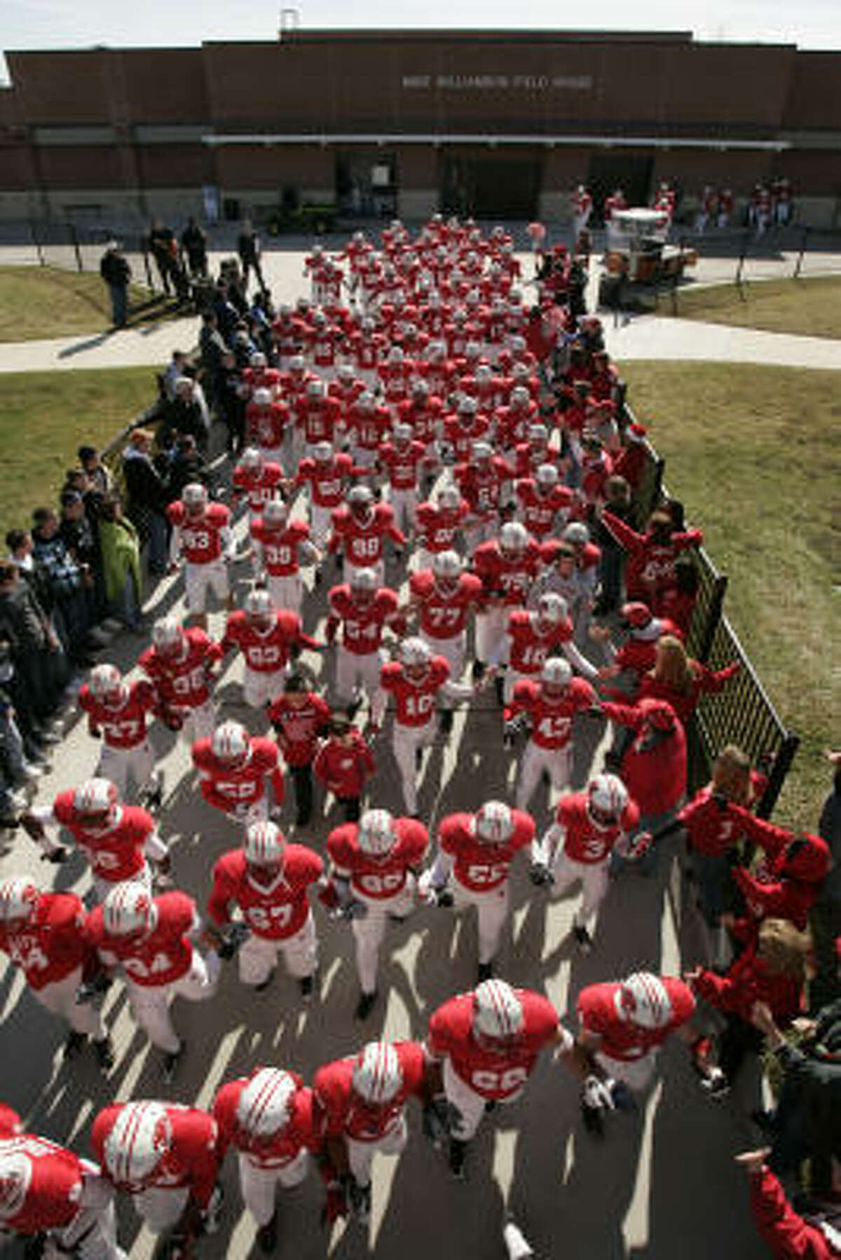 The Katy Tigers make their way onto the field to face the Clear Springs Chargers before the 5A Region III championship, Saturday at Tully Stadium.