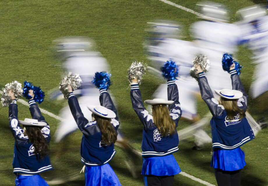 FRIENDSWOOD 46, WALTRIP 2:Friendswood players race onto the field past the  dance team before facing Waltrip in the second round of the Class 4A playoffs at Galena Park. Photo: Smiley N. Pool, Houston Chronicle