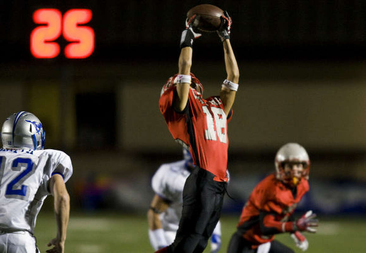 Waltrip receiver Dominic Moreno (18) reaches up to catch a pass during the first half as Waltrip faces Friendswood at Galena Park ISD Stadium Nov. 21.