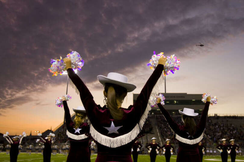 Cinco Ranch drill team members cheer before teams take the field for first half action in a high sch