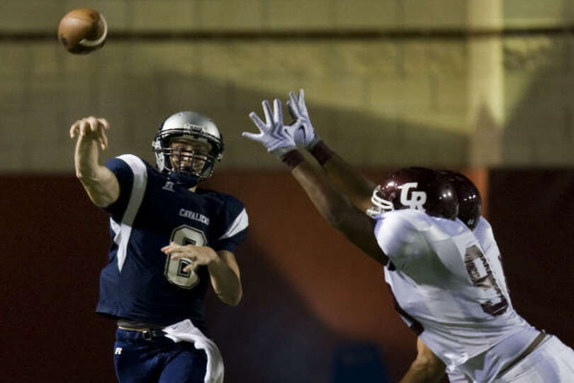 College Park quarterback Taylor Parsons fires a pass over the Cinco Ranch rush.
