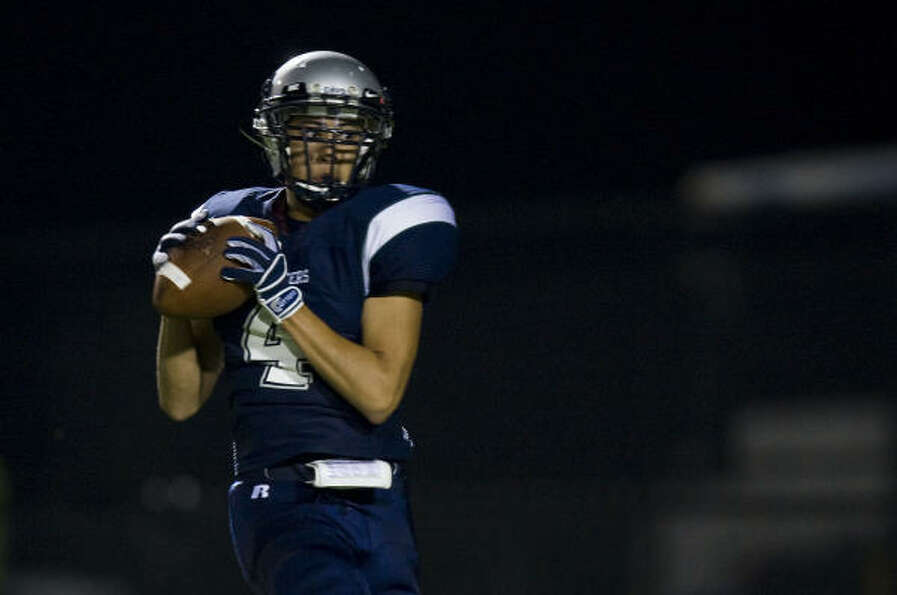 College Park receiver Ryan Kim hauls in a wide open touchdown reception to open the scoring against
