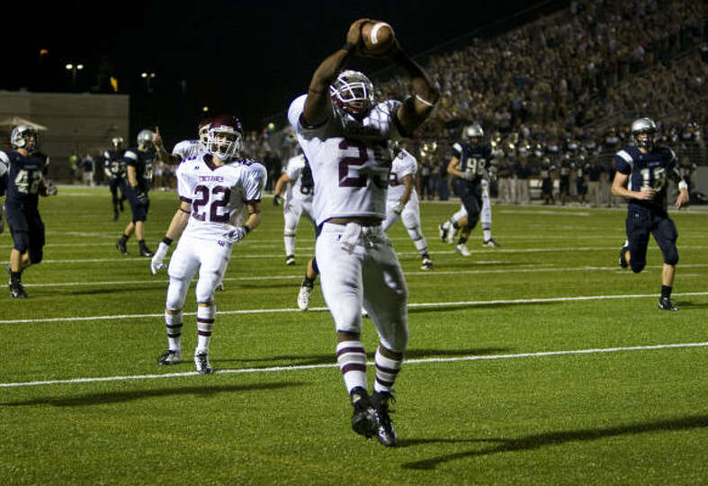 Cinco Ranch running back K.C. Nlemchi celebrates as he crosses the goal line to score a touchdown fo