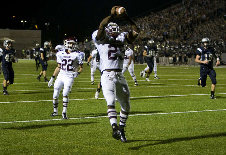 Cinco Ranch running back K.C. Nlemchi celebrates as he crosses the goal line to score a touchdown for the Cougars during the third quarter against College Park. Photo: Smiley N. Pool, Houston Chronicle