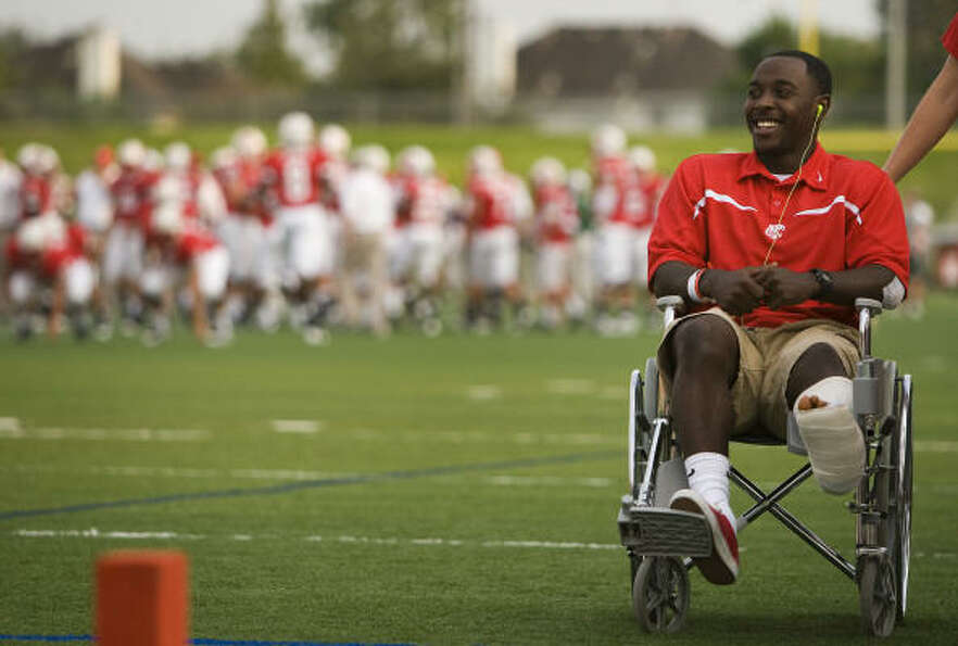 Injured Katy running back Donovonn Young watches from a wheelchair before the Tigers take on The Woo