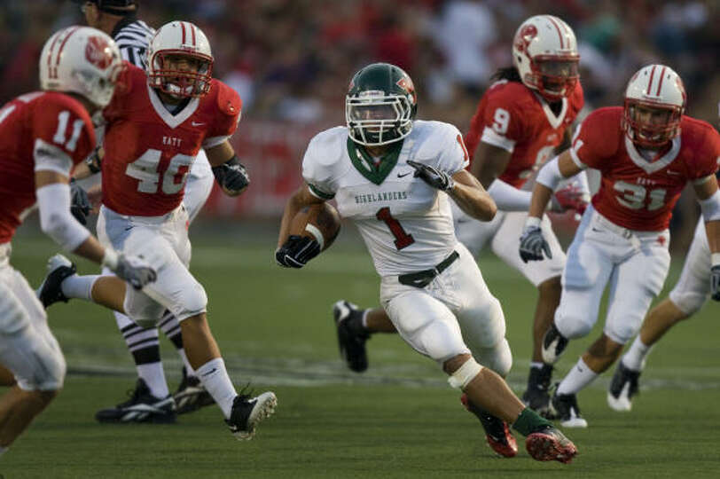 Daniel Lasco of The Woodlands races 44 yards through the Katy defense for a touchdown during first h