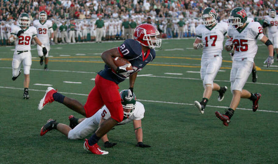 Defensive back Michael Skaufel of The Woodlands Highlanders can't defend against halfback Randall Ho