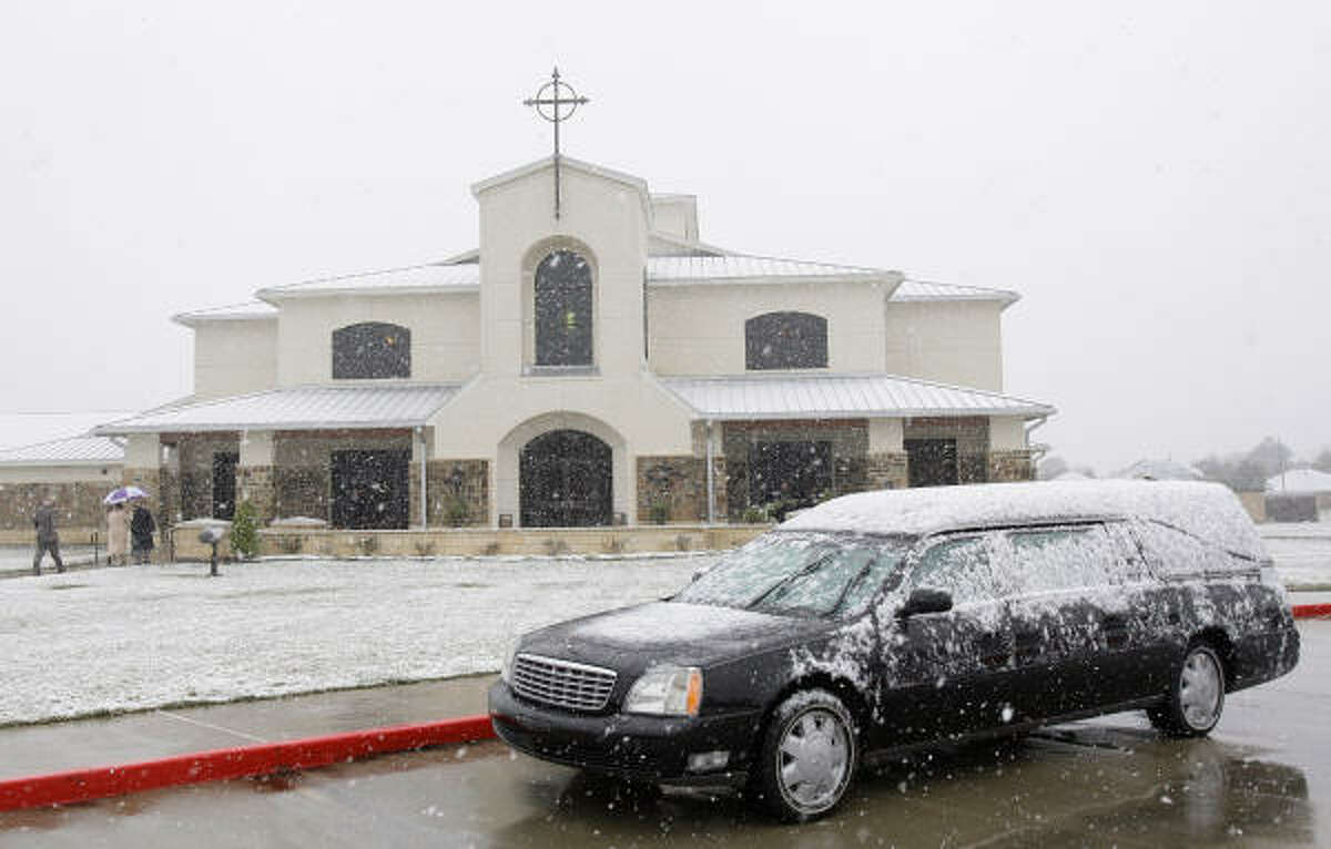 Snow gathers on the hearse outside the funeral service for Army Sgt. James Michael Nolen at Friendswood United Methodist Church. Sgt. Nolen, 25, who was killed in action with a fellow soldier in Afghanistan on Nov. 22 when their military vehicle hit an improvised explosive device. Nolen was married to a pregnant wife who is expecting their first child in May. He was about to celebrate his first wedding anniversary on Dec. 1st.