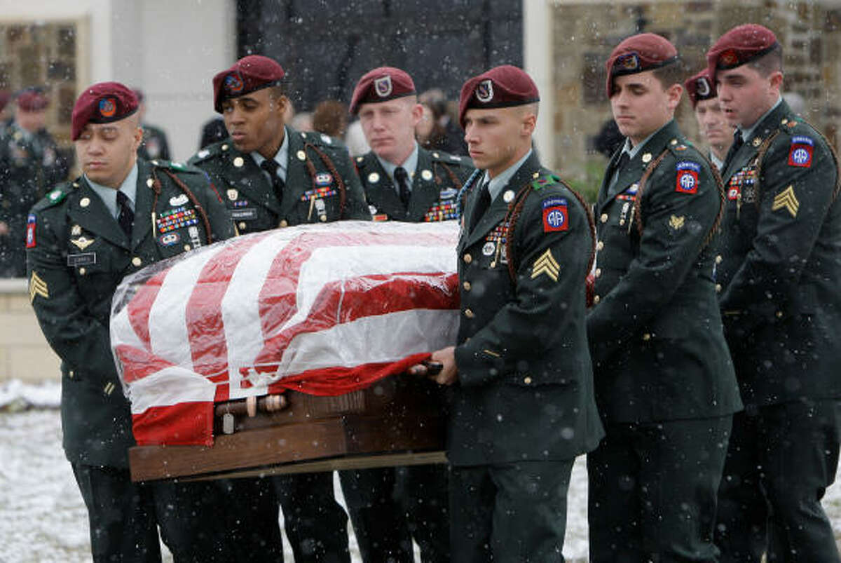 Honor Guard members from Fort Bragg carry the casket after funeral service for Army Sgt. James Michael Nolen.