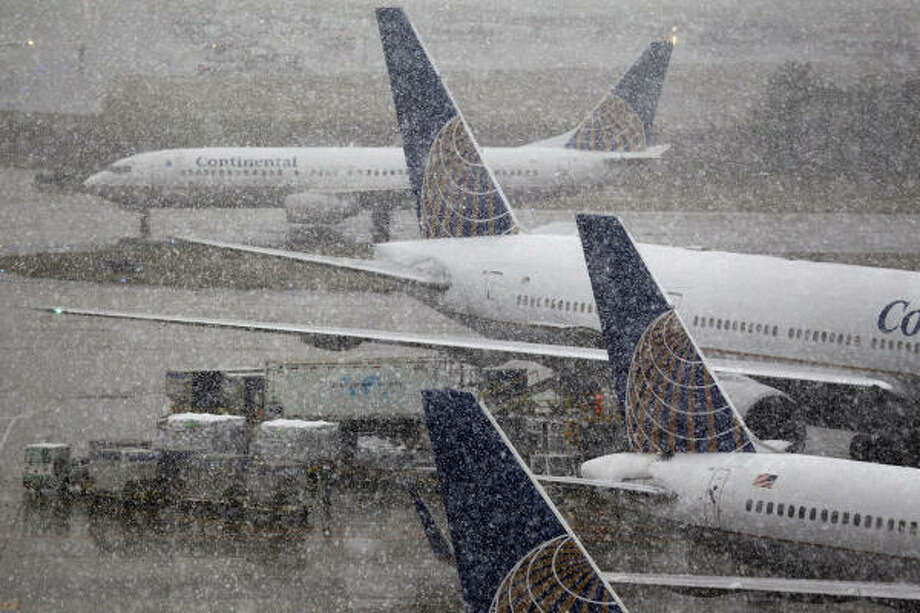 Snow falls at Bush Intercontinental Airport on Friday. Several flights were canceled at both Bush and Hobby Airport. Photo: Smiley N. Pool, Chronicle