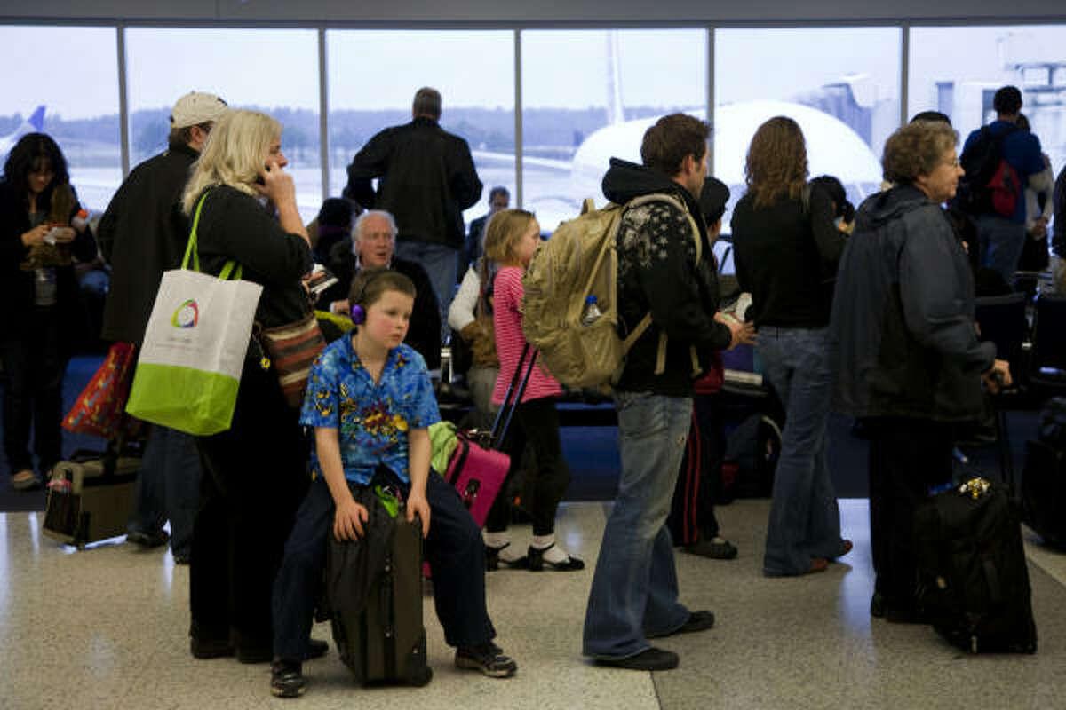 Passengers wait to board a delayed flight at Bush.