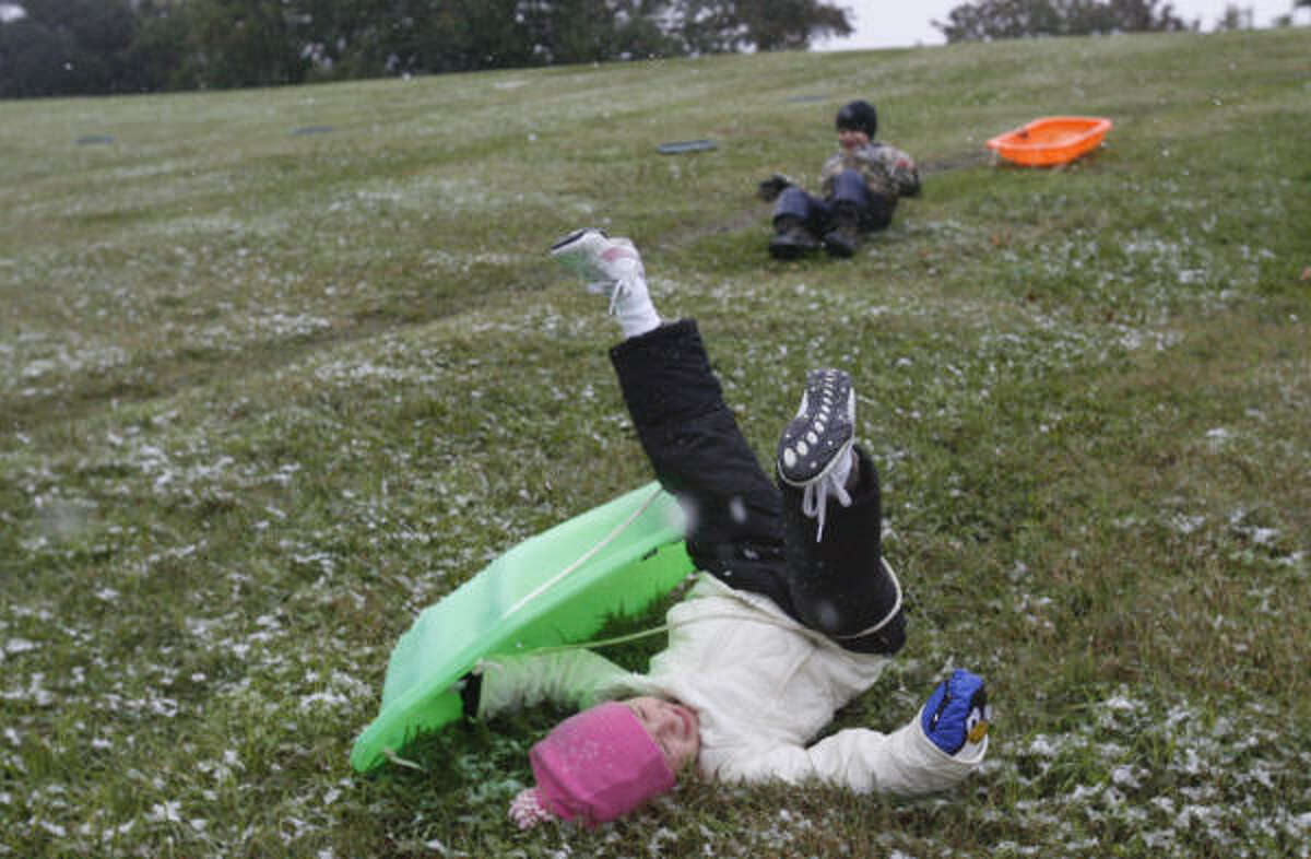 Sledding down a hill can be fun, but Claire Facundo, 4, wipes out along Allen Parkway.