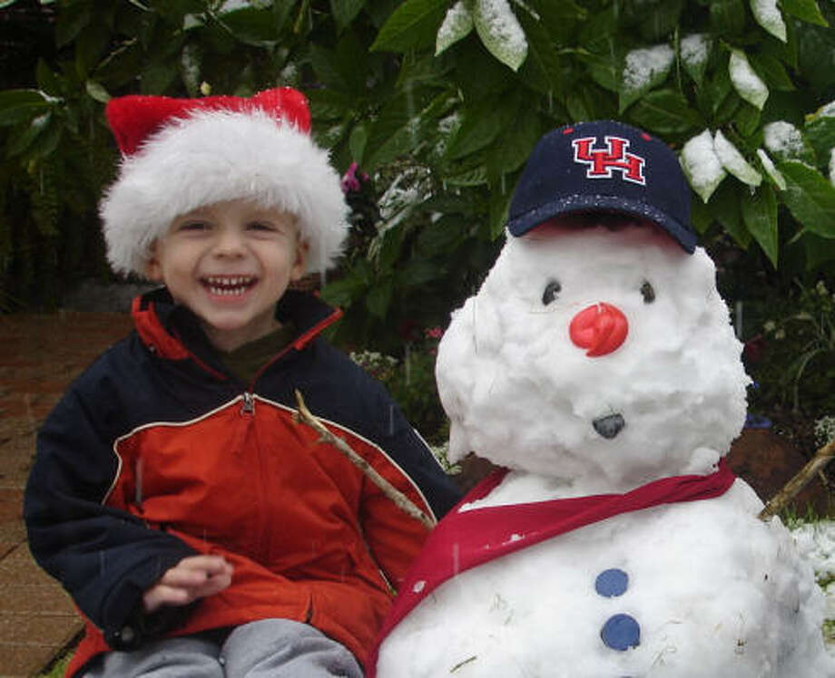 Colin Hageney and Snowman by ColinHageney  Jr. and his Cougar Snowman! Photo: ColinHageney, Chron.commons