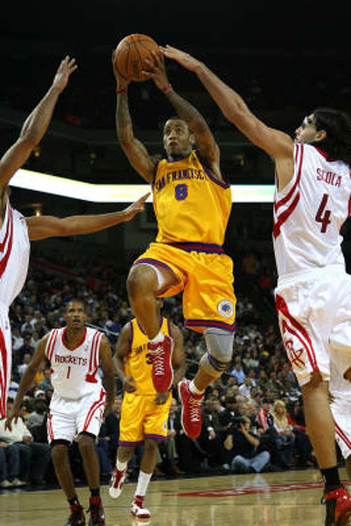 Warriors guard Monta Ellis drives against Rockets forward Luis Scola.