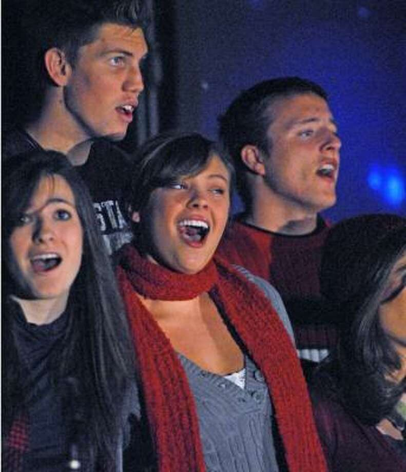 HOLIDAY MOOD:Bravo Show Choir members from Cinco Ranch High perform during the annual Community Christmas Tree Lighting ceremony at The Fellowship at Cinco Ranch. Photo: Tony Bullard, For The Chronicle