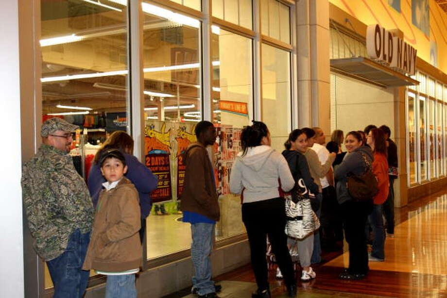Customers wait for Old Navy store in Katy Mills Mall to open at midnight on Black Friday. Holy Week is also a big retail time for the outlet mall. Photo: Suzanne Rehak, For The Chronicle