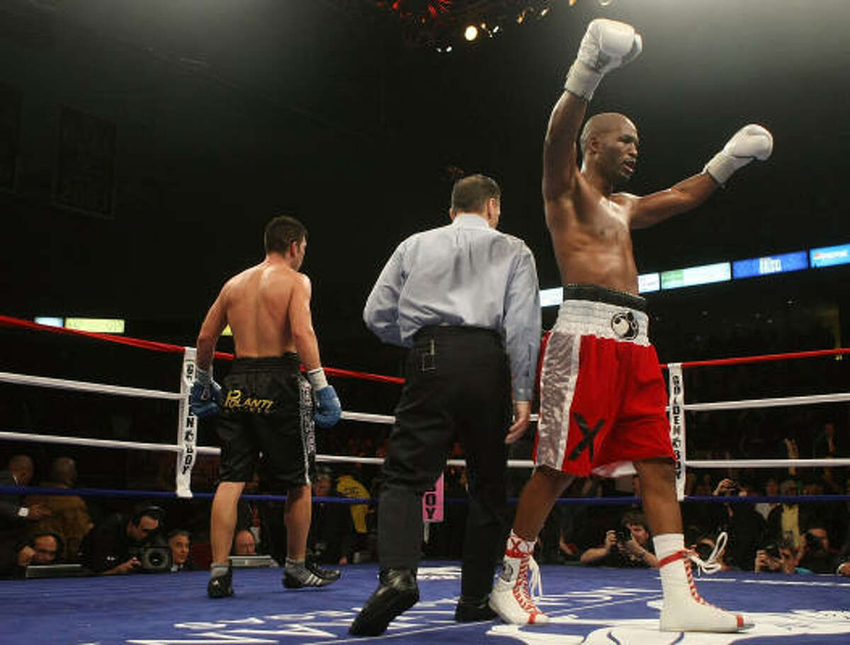 Bernard Hopkins celebrates at the final bell against Enrique Ornelas after their light heavyweight bout at The Liacouras Center.