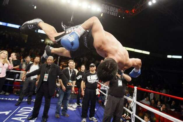 Enrique Ornelas flips from the top rope as he makes his way into the ring. Photo: Matt Slocum, AP